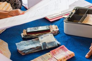 Should You Take a Loan or Cash In Your Savings